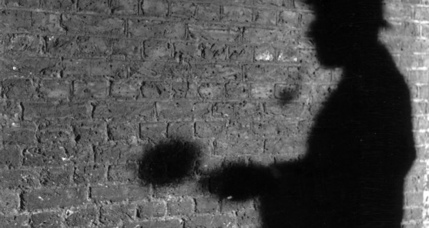 February 1968:  The shadow of R A Rendel, publicity manager for the Abbey National Building Society, in the guise of fictional detective Sherlock Holmes. Mr Rendel answers the fan mail sent to Holmes' address at 221b Baker Street, a site now occupied by the building society.  (Photo by Peter Ruck/BIPs/Getty Images)